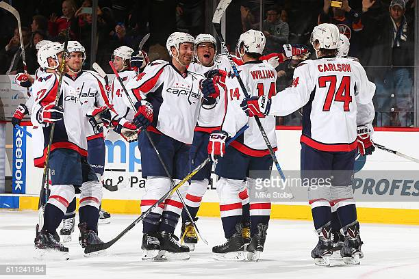 Justin Williams of the Washington Capitals celebrates his game winning overtime goal with Alex Ovechkin and Brooks Orpik against the New York...