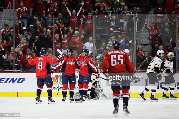 Justin Williams of the Washington Capitals celebrates his second goal of the first period with teammates Dmitry Orlov and Matt Niskanen against the...