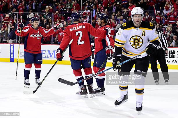 Justin Williams of the Washington Capitals celebrates his second goal of the game with his teammates Matt Niskanen and Dmitry Orlov in the first...