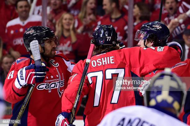 Justin Williams of the Washington Capitals celebrates with his teammates after scoring a goal in the first period against the Toronto Maple Leafs in...