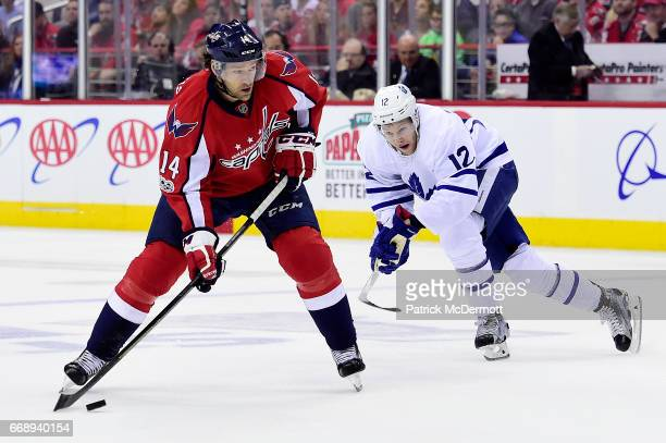 Justin Williams of the Washington Capitals controls the puck against Connor Brown of the Toronto Maple Leafs in the first period in Game Two of the...