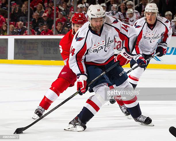 Justin Williams of the Washington Capitals shoots the puck during an NHL game against the Detroit Red Wings at Joe Louis Arena on November 10 2015 in...