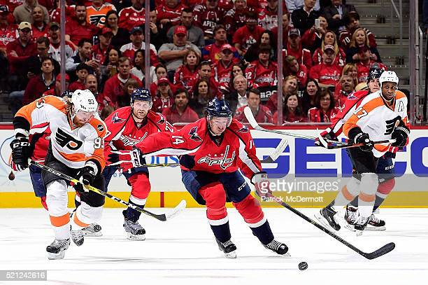 Justin Williams of the Washington Capitals skates with the puck against  Jakub Voracek of the Philadelphia 781c29ef688