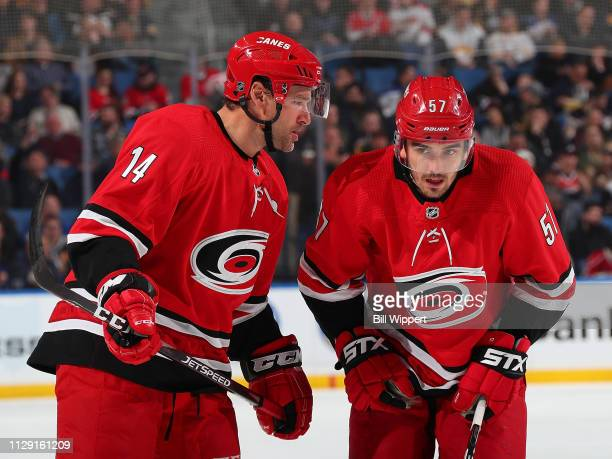Justin Williams talks to Trevor van Riemsdyk of the Carolina Hurricanes during an NHL game against the Buffalo Sabres on February 7 2019 at KeyBank...