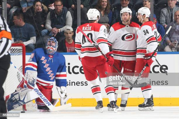 Justin Williams Victor Rask and Phillip Di Giuseppe of the Carolina Hurricanes celebrate after scoring a goal against Henrik Lundqvist of the New...