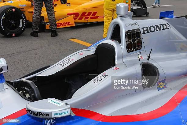 Justin Wilson driver of the Andretti Autosports Honda sits empty on the grid prior to the Verizon IndyCar Series ABC Supply 500 at Pocono Raceway in...