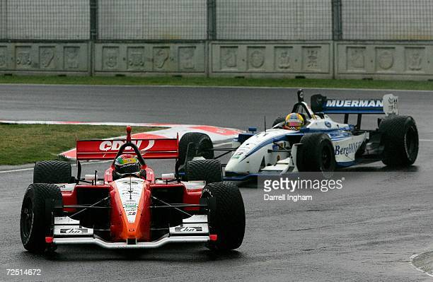 Justin Wilson drives the RuSport Lola Cosworth ahead of Jan Heylen in the Dale Coyne Racing Lola Cosworth during the ChampCar World Series Gran...