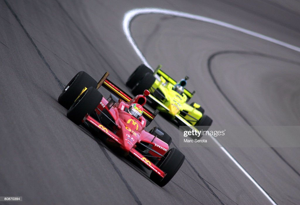 Justin Wilson in the #02 McDonald's Newman/Haas/Laningan Racing Dallara Honda and Ed Carpenter in the #20 Menards/Vision racing car during practice for the IRL IndyCar Series Road Runner Turbo Indy 300 at the Kansas Speedway on April 26, 2008 in Kansas City, Missouri.