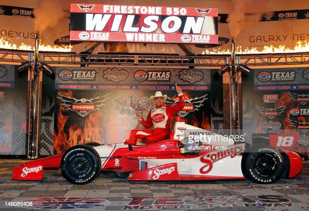 Justin Wilson of England driver of the Sonny's BBQ Honda Dallara celebrates in Victory Lane after winning the IZOD IndyCar Series Firestone 550 at...
