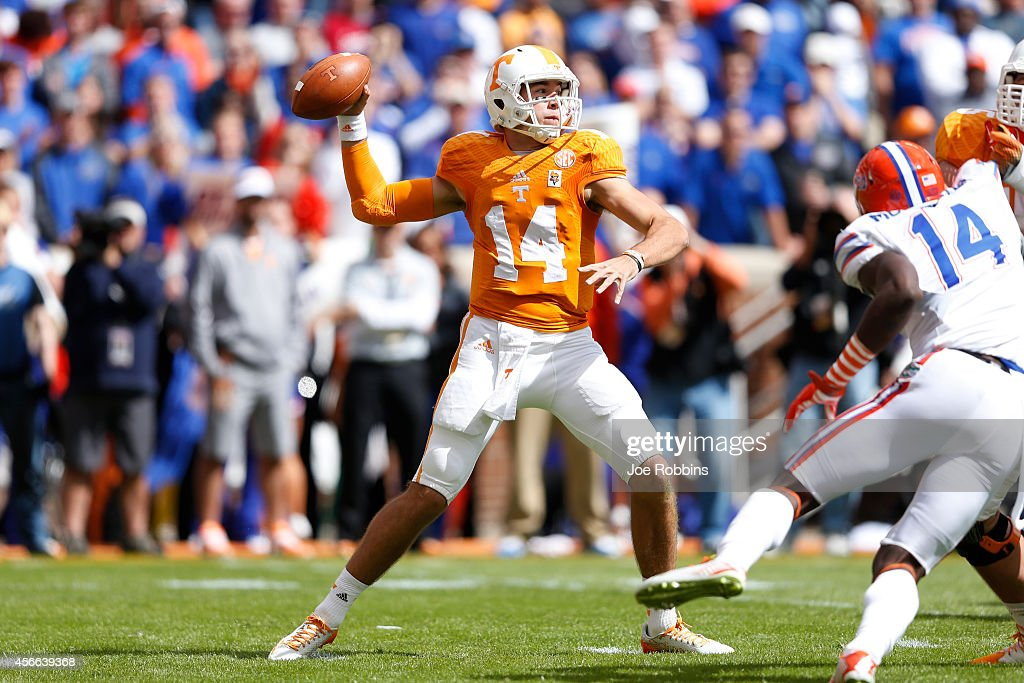 Justin Worley #14 of the Tennessee Volunteers throws a pass during the first half of the game against the Florida Gators at Neyland Stadium on October 4, 2014 in Knoxville, Tennessee.