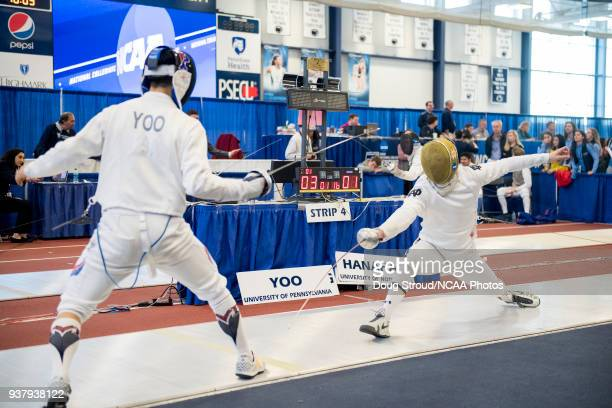 Justin Yoo of Pennsylvania University takes on Nicholas Hanahan of Notre Dame University in the epee preliminary round during the Division I Men's...