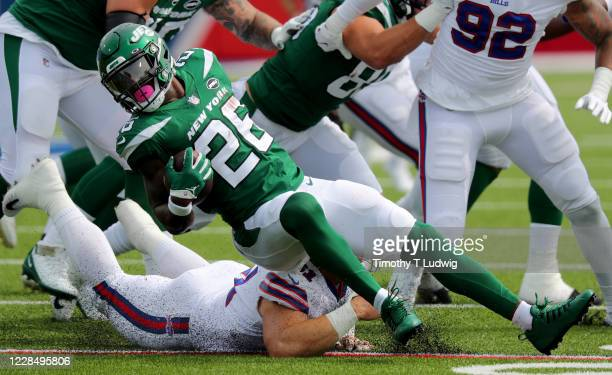 Justin Zimmer of the Buffalo Bills dives to make a tackle on Le'Veon Bell of the New York Jets during the first quarter at Bills Stadium on September...