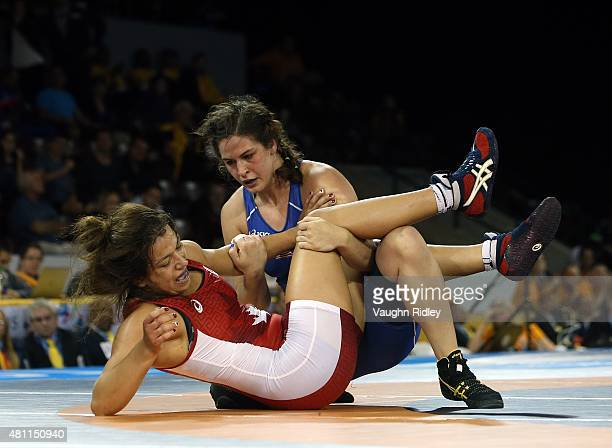 Justina Distasio of Canada and Adeline Gray of the USA compete in the Women's 75kg Freestyle Final during the Toronto 2015 Pan Am Games at the...