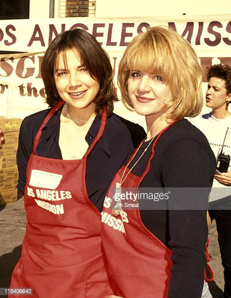 Justine Bateman and Tina Yothers during Celebrity Volunteers Feed Thanksgiving Dinner to the Homeless November 23 1994 at LA Mission in Los Angeles...