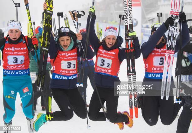 Justine Braisaz Celia Aymonier Anais Chevalier and Anais Bescond of team France celebrate after winning the women's 4 x 6 km relay event of the IBU...