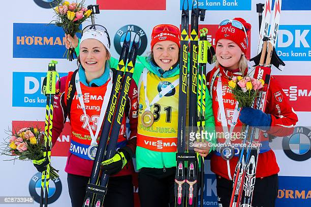 Justine Braisaz of France takes 2nd place Laura Dahlmeier of Germany takes 1st place Marte Olsbu of Norway takes 3rd place during the IBU Biathlon...