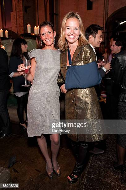 Justine DobbsHigginson and Marissa Anshutz attend the private view of 'Unseen Guy Bourdin' at The Wapping Project on May 7 2009 in London England