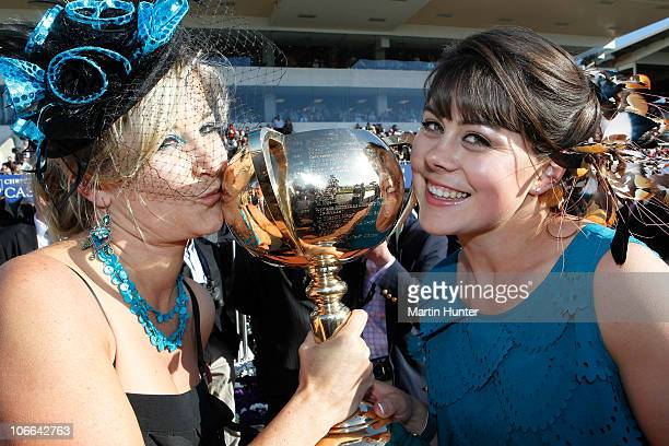 Justine Fisher and Sarah Famularo celebrate with the New Zealand Trottting Cup during the Casino NZ Trotting Cup Day at Addington Raceway on November...