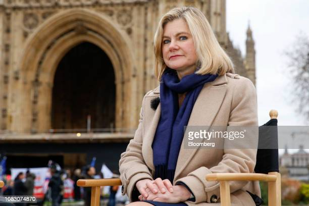 Justine Greening a Conservative lawmaker pauses during a Bloomberg Television interview near the Houses of Parliament in London UK on Tuesday Jan 15...