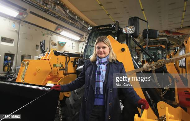 Justine Greening Secretary of State for International Development poses for a photograph with vehicles and humanitarian aid that have been loaded...