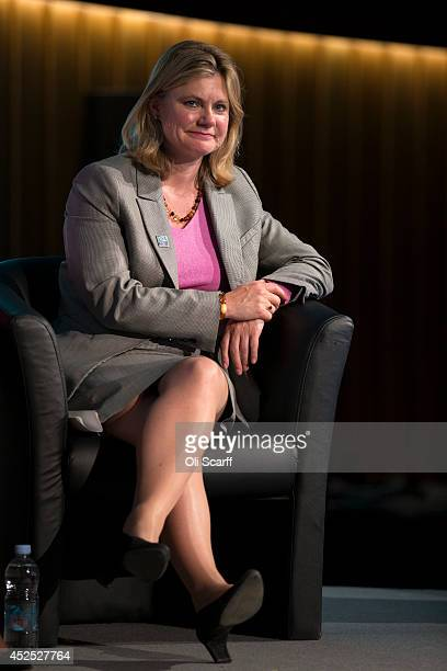 Justine Greening the Secretary of State for International Development listens to the speeches at the 'Girl Summit 2014' in Walworth Academy on July...
