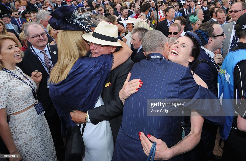 Justine Hales (foreman for Waller Racing) hugging owner Peter Tighe after Winx won Race 9, the William Hill Cox Plate during Cox Plate Day at Moonee Valley Racecourse on October 24, 2015 in Melbourne, Australia.