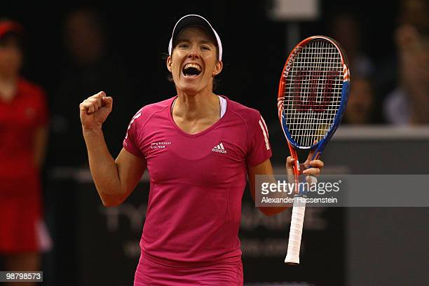 Justine Henin of Belgium celebrates victory after winning her final match against Samantha Stosur of Australia at the final day of the WTA Porsche...