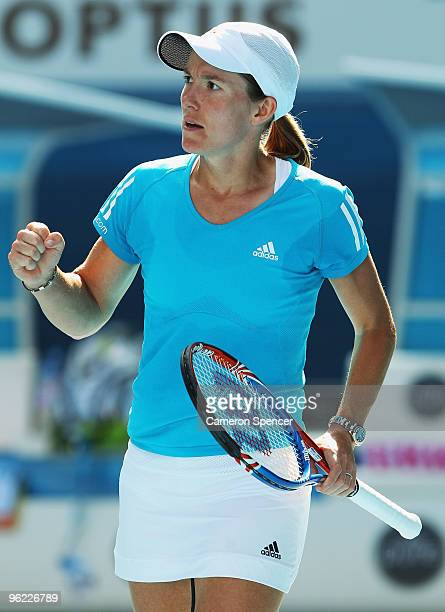 Justine Henin of Belgium celebrates winning a point in her semifinal match against Jie Zheng of China during day eleven of the 2010 Australian Open...