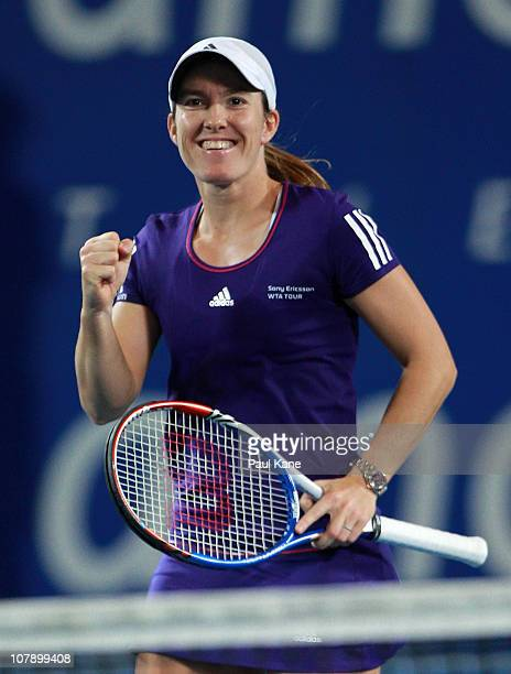 Justine Henin of Belgium celebrates winning her singles match against Ana Ivanovic of Serbia on day six of the Hopman Cup at The Burswood Dome on...