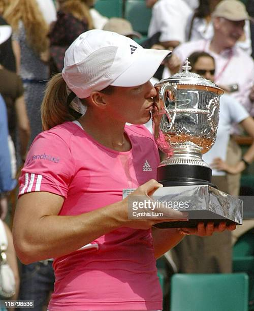 Justine Henin of Belgium, celebrates winning the 2007 French Open Womens title, defeating Ana Ivanovic of Serbia 6-1, 6-2 in the final at Roland...
