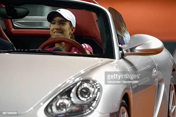 Justine Henin of Belgium drives with her winners present a Porsche Boxter Spyder after winning her final match against Samantha Stosur of Australia...
