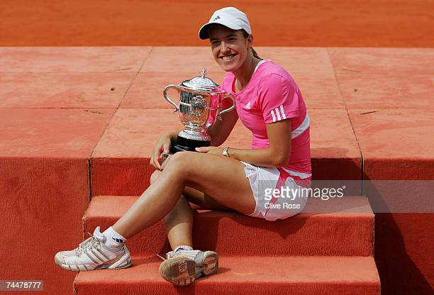 Justine Henin of Belgium holds the trophy after winning against Ana Ivanovic of Serbia in the Women's Singles Final on day fourteen of the French...