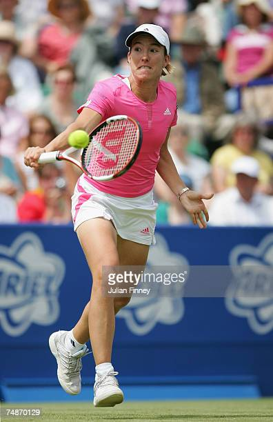 Justine Henin of Belgium plays a backhand in her match against Amelie Mauresmo of France during the finals of the International Women's Open Tennis...