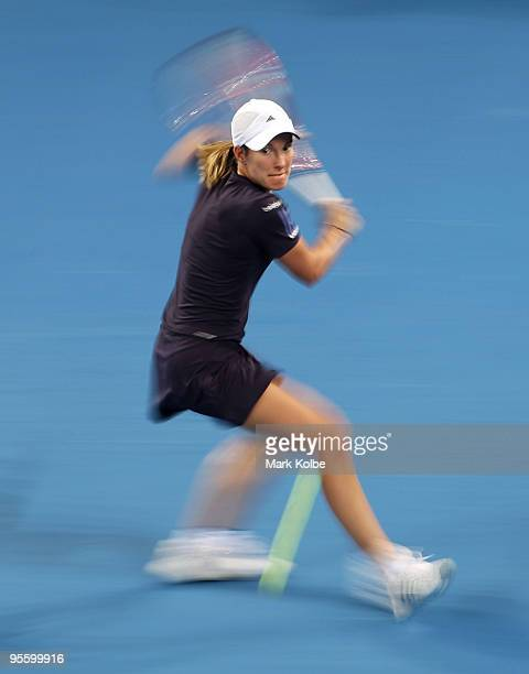 Justine Henin of Belgium plays a backhand in her second round match against Sesil Karatantcheva of Kazakhstan during day four of the Brisbane...
