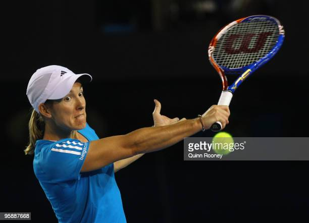 Justine Henin of Belgium plays a backhand in her second round match against Elena Dementieva of Russia during day three of the 2010 Australian Open...
