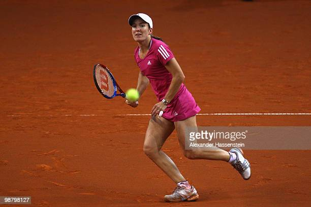 Justine Henin of Belgium plays a fore hand during her final match against Samantha Stosur of Australia at the final day of the WTA Porsche Tennis...