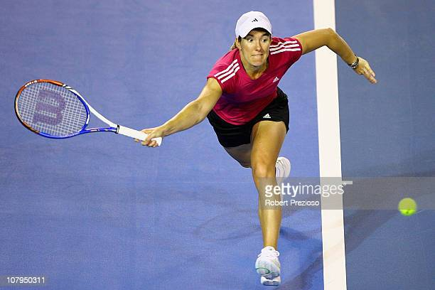 Justine Henin of Belgium plays a forehand during a practice session ahead of the 2011 Australian Open at Melbourne Park on January 10, 2011 in...