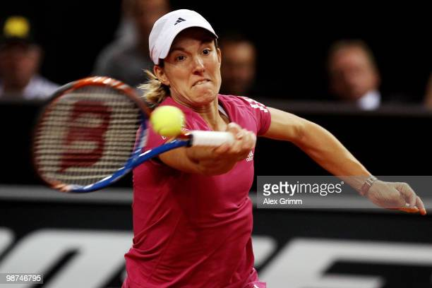 Justine Henin of Belgium plays a forehand during her second round match against Yanina Wickmayer of Belgium at day four of the WTA Porsche Tennis...