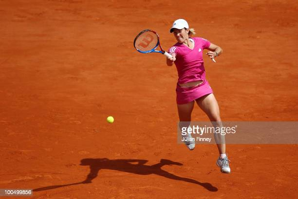 Justine Henin of Belgium plays a forehand during the women's singles first round match between Justine Henin of Belgium and Tsvetana Pironkova of...