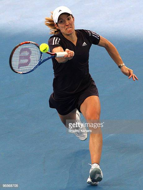 Justine Henin of Belgium plays a forehand in her first round match against Nadia Petrova of Russia during day two of the Brisbane International 2010...