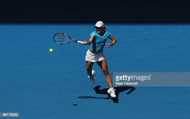 Justine Henin of Belgium plays a forehand in her quarterfinal match against Nadia Petrova of Russia during day nine of the 2010 Australian Open at...
