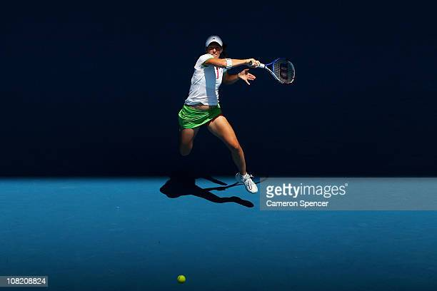 Justine Henin of Belgium plays a forehand in her third round match against Svetlana Kuznetsova of Russia during day five of the 2011 Australian Open...