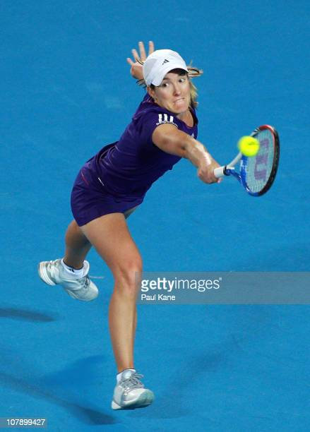 Justine Henin of Belgium plays a return shot during her singles match against Ana Ivanovic of Serbia on day six of the Hopman Cup at The Burswood...