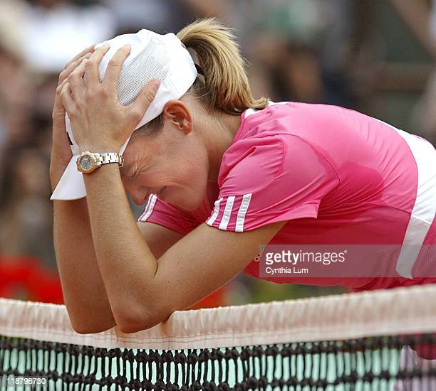 Justine Henin of Belgium rests on the nets and celebrates winning the 2007 French Open Womens title defeating Ana Ivanovic of Serbia 61 62 in the...