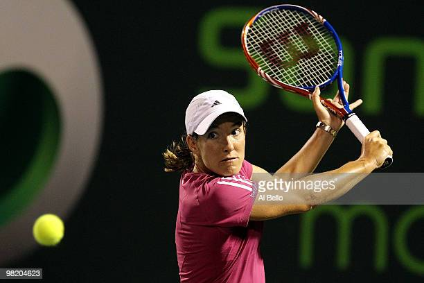 Justine Henin of Belgium returns a shot against Kim Clijsters of Belgium during day ten of the 2010 Sony Ericsson Open at Crandon Park Tennis Center...