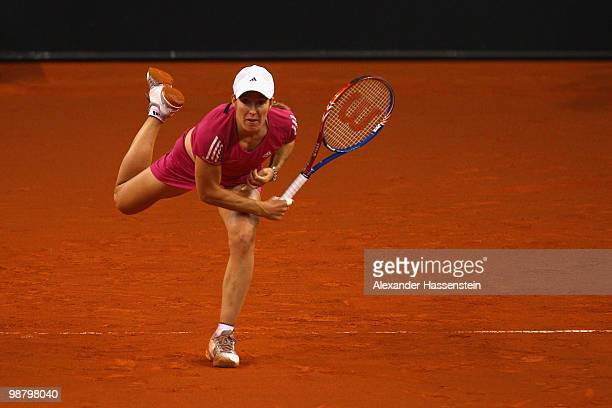 Justine Henin of Belgium serves during her final match against Samantha Stosur of Australia at the final day of the WTA Porsche Tennis Grand Prix...