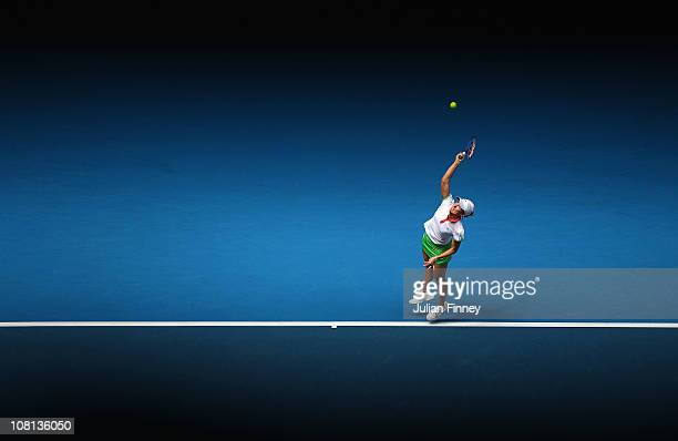 Justine Henin of Belgium serves in her second round match against Elena Baltacha of Great Britain during day three of the 2011 Australian Open at...