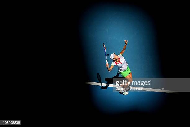 Justine Henin of Belgium serves in her third round match against Svetlana Kuznetsova of Russia during day five of the 2011 Australian Open at...