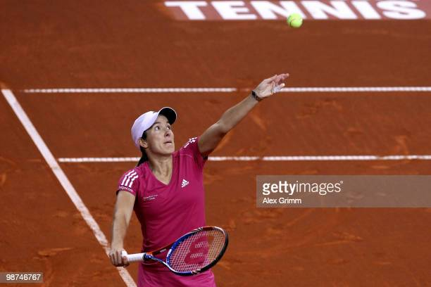Justine Henin of Belgium serves the ball during her second round match against Yanina Wickmayer of Belgium at day four of the WTA Porsche Tennis...