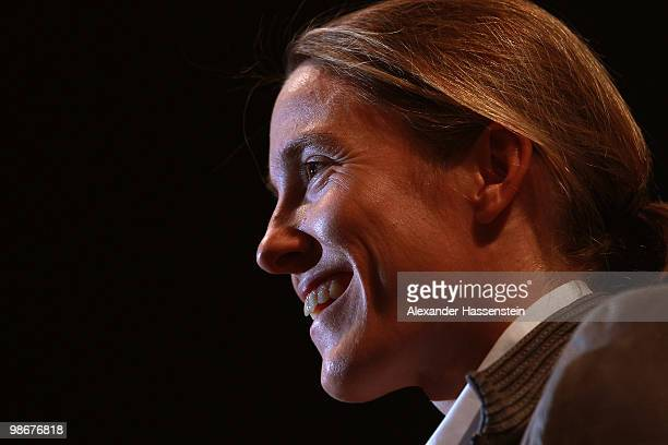Justine Henin of Belgium smiles during the Player presentation at day one of the WTA Porsche Tennis Grand Prix Tournament at the Porsche Arena on...